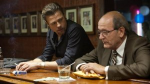 Enforcer Jacki Cogan (Brad Pitt) and mob bean-counter (Richard Jenkins) in Killing Them Softly
