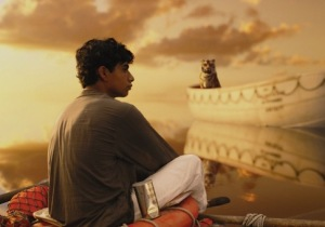 Pi (Suraj Sharma) adrift at sea with tiger Richard Parker in Life of Pi