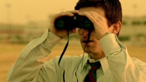 Aaron (Shane Carruth) can't quite believe who he's warching in Primer