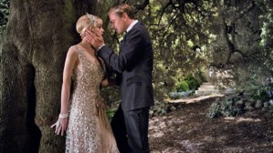 Daisy (Carey Mulligan) and Gatsby (Leonardo DiCaprio) steal a kiss in The Great Gatsby