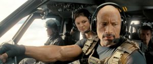 Agent Luke Gibbs (Dwayne Johnson) and Riley (Gina Carano) look on impressed in Fast and Furious 6