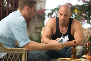 Brian (Paul Walker) and Dom (Vin Diesel) discuss where to go next in Fast and Furious 6