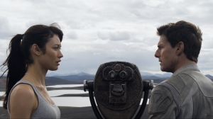 """I know you don't I?"" Julia (Olga Kurylenko) is questioned by Jack (Tom Cruise) in Oblivion"