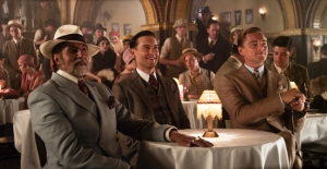 Nick Carraway (Tobey Maguire), sandwiched between dodgy businessman Meyer Wolfsheim (Bollywood star Amitabh Bachchan) and Jay Gatsby (Leonardo DiCaprio) in The Great Gatsby