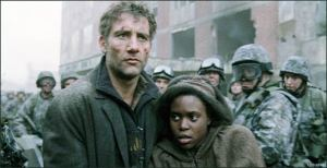 Theo (Clive Owen) leads Kee (Clare-Hope Ashitey) to safety in Children Of Men