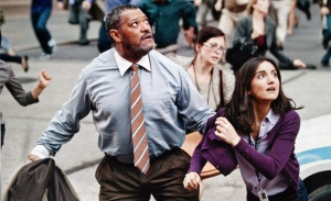 Daily Planet editor Perry White (Laurence Fishburne) and his staff take shelter in Man Of Steel