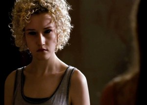 Gwen (Julia Garner) looking bland/evil in The Last Exorcism Part II