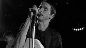 Ian Curtis (Sean Harris) on stage in 24 Hour Party People