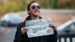 Gary (Simon Pegg) unveils the map of 'the golden mile' showing all 12 watering holes in The World's End