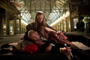 A broken Joey Smith (Jason Statham) is held by Sister Cristina (Agata Buzek) in Hummingbird