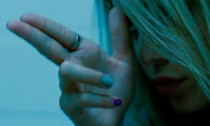 Brittany (Ashley Benson) pretends it's just a video game in Spring Breakers
