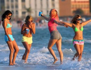 Candy (Vanessa Hudgens), Brittany (Ashley Benson), Cotty (Rachel Korine) and Faith (Selena Gomez) let their hair down in Spring Breakers