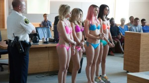 Candy (Vanessa Hudgens), Brittany (Ashley Benson), Cotty (Rachel Korine) and Faith (Selena Gomez) in trouble in Spring Breakers