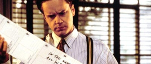 Griffin Mill (Tim Robbins) receives yet another death-threatening postcard from a mystery writer in The Player