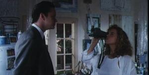Studio exec Griffin Mill (Tim Robbins) sets his sights on artist June Gudmundsdottir (Greta Scacchi) in The Player