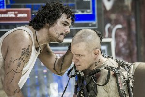 Smuggler/hacker Spider (Wagner Moura) checks on an exo-skeletal Max (Matt Damon) in Elysium
