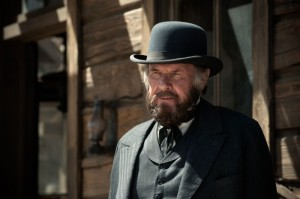 Railroad tycoon Latham Cole (Tom Wilkinson) in The Lone Ranger