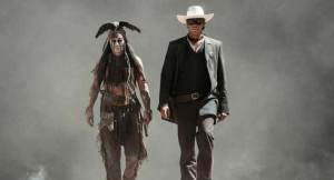Tonto (Johnny Depp) and John 'Lone Ranger' Reid (Armie Hammer) stride purposefully in The Lone Ranger