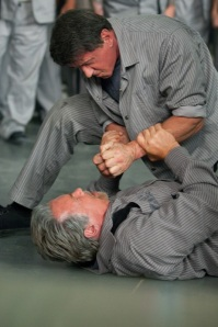 Inmates Ray Breslin (Sylvester Stallone) and Emil Rottmayer (Arnold Schwarzenegger) get acquainted in Escape Plan