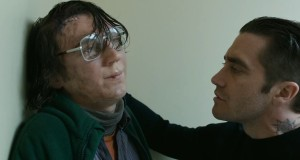 Prime suspect Alex (Paul Dano) is interrogated by Detecive Loki (Jake Gyllenhaal) in Prisoners