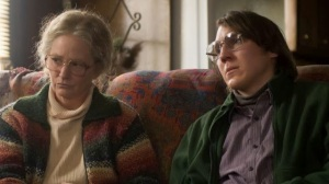 Aunt Holly (Melissa Leo) protects Alex (Paul Dano) in Prisoners