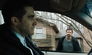 Keller Dover (Hugh Jackman) demands action from Detective Loki (Jake Gyllenhaal) to find his daugher in Prisoners