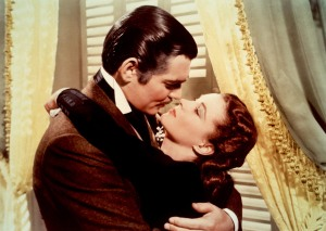 Rhett Butler (Clark Gable) and Scarlett O'Hara (Vivien Leigh) trike a classic pose from Gone With The Wind