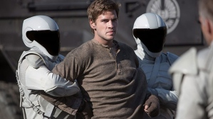 Gale Hawthorne (Liam Hemsworth) defies the authorities in The Hunger Games: Catching Fire
