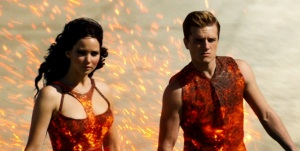 Katniss Everdeen (Jennifer Lawrence) and Peeta Mellark are the girl, and boy, on fire in The Hunger Games: Catching Fire