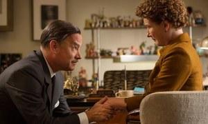 Walt Disney (Tom Hanks) promises he won't let Mrs Travers (Emma Thompson) down in Saving Mr Banks