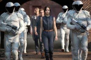 Katniss Everdeen (Jennifer Lawrence), Peeta Mellark (Josh Hutcherson) and Haymitch Abernathy (Woody Harrelson) must jump through President Snow's hoops in The Hunger Games: Catching Fire