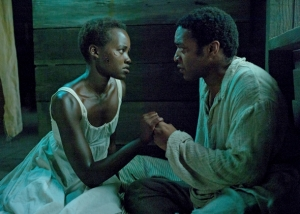Patsey (Lupita Nyong'o) begs Solomon (Chiwetel Ejiofor) for help in 12 Years A Slave