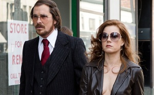 Irving Rosenfeld (Christian Bale) and partner-in-crime/girlfriend Sydney Prosser (Amy Adams) in American Hustle