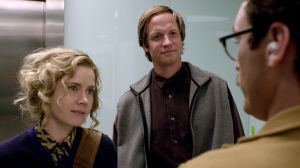 Theodore (Joaquin Phoenix) bumps into good friend Amy (Amy Adams) and her husband Charles (Matt Letscher) in Her