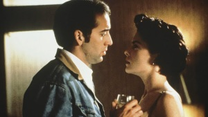 Michael (Nicolas Cage) gets himself into hot water with Wayne's wife Suzanne (Lara Flynn Boyle) in Red Rock West