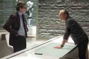 OmniCorp CEO Raymond Sellars (Michael Keaton) plots with Dr Dennett Norton (Gary Oldman) in RoboCop