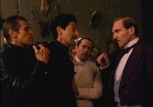 M. Gustave H. (Raplh Fiennes) confronts the dastardly Dmitri Desgoffe-und-Taxis (Adrieb Brody) and his henchman J.G. Jopling (Willem Dafoe) in The Grand Budapest Hotel