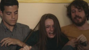 Mason (John Gallagher Jr) and Nate (Rami Malek) try to calm down tearaway teen Jayden (Kaitlyn Dever) in Short Term 12