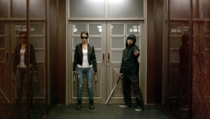 Baseball Bat Man (Very Tri Yulisman) and Hammer Girl (Julie Estelle) get ready for some ultraviolence in The Raid 2