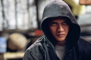 SWAT member turned undercover officer Rama (Iko Uwais) in The Raid 2