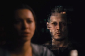 Will (Johnny Depp) reaches out to Evelyn (Rebecca Hall) beyond the internet in Transcendence