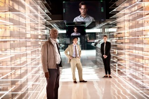 Scientist Joseph Tagger (Morgan Freeman) and FBI agent Donald Buchanan (Cillian Murphy) are shown around by Will's wife Evelyn (Rebecca Hall) in Transcendence