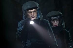 Scientists  Ishiro Serizawa (Ken Watanabe) and Vivienne Graham (Sally Hawkins) investigate in Godzilla