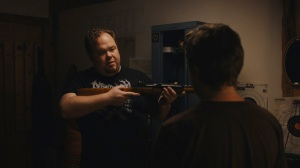 Ben (Devin Ratray) shows Dwight (Macon Blair) the ropes of how to use a gun in Blue Ruin