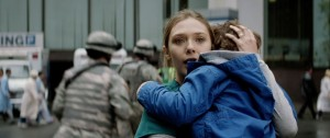 A terrified Elle (Elizabeth Olson) and son hope for the safe return of husband Ford (Aaron-Taylor Johnson) in Godzilla
