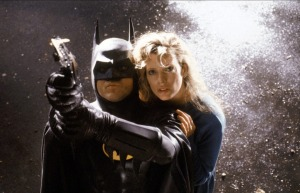 Batman (Michael Keaton) protects reporter Vicky Vale (Kim Basinger) in Batman