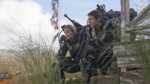 Major William Cage (Tom Cruise) and Special Forces soldier Rita Vrataski (Emily Blunt) consider their next move in Edge Of Tomorrow