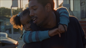 Oscar (Michael B. Jordan) hangs out with his daughter Tatiana (Ariana Neal) in Fruitvale Station
