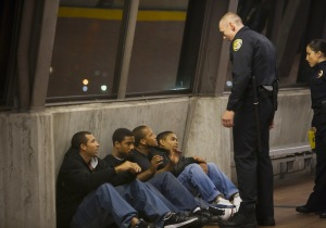 Officer Caruso (Kevin Durand) imposes himself on Oscar (Michael B. Jordan) and his friends in Fruitvale Station