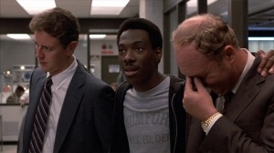 Axel Foley (Eddie Murphy) gets under the skin of Rosewood (Judge Reinhold) and Taggart (John Ashton) in Beverly Hills Cop